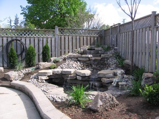 Backyard waterfall pictures source download large faux for Build a koi pond yourself